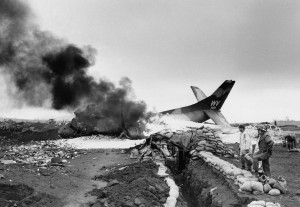 (An American C-123 cargo plane burns after being hit by communist mortars while taxiing on the Marine post at Khe Sanh, South Vietnam on March 1, 1968. Originaly: AP Photo/Peter Arnett. Source: Flickr, posted by manhhai, attribution required).