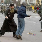 Priest intervenes with between police and rioter