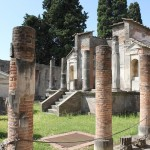 The Temple of Isis at Pompeii.  A few dozen people could stand in the courtyard, but only a handful of priests would fit in the sanctuary itself.  Temples don't have to be large.