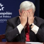 U.S. Republican presidential candidate former U.S. House Speaker Gingrich covers his face with his hands in Manchester