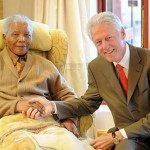 Clinton pays Nelson Mandela a surprise birthday visit