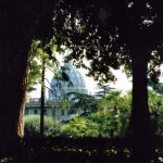 A breathtaking view of the dome of St. Peter's Basilica, seen from the rear of the Vatican Gardens