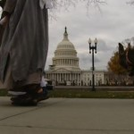 A shepherd and a burro pass the U.S. Capitol in the 2011 Living Nativity
