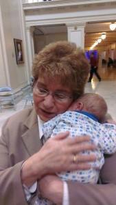 Representative Rebecca Hamilton holds a baby in the Oklahoma Legislature
