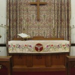 The historic altar cloth on the altar at Dearborn's Atonement Lutheran Church
