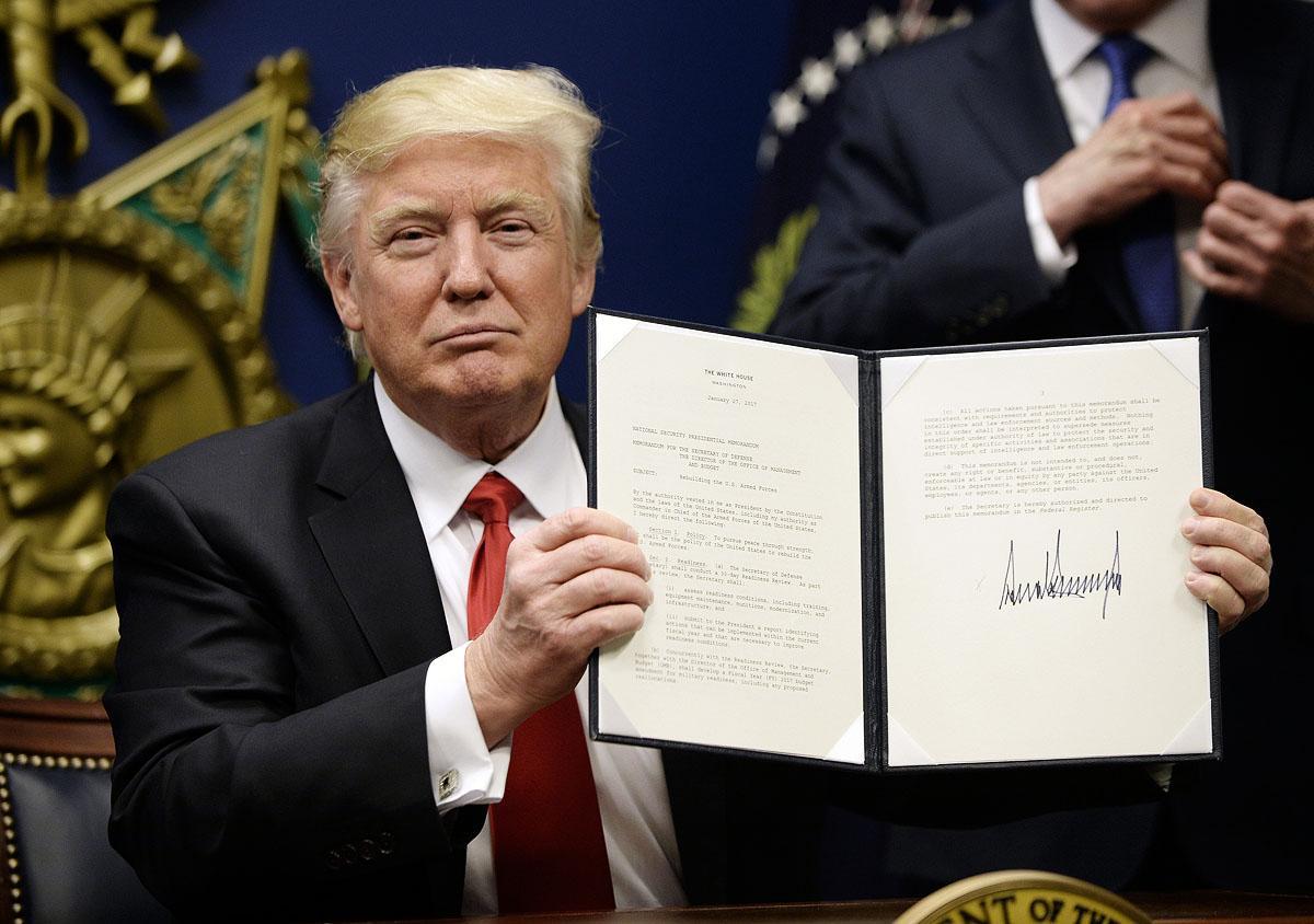 TrumpSignsOrderBarMuslims