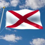 stock-footage-looping-movie-of-the-alabama-state-flag-waving-in-the-wind-with-lightly-clouded-blue-sky-background