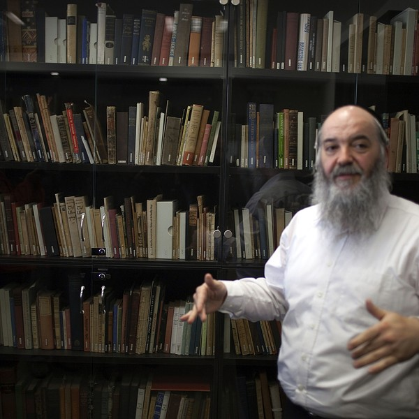 Dr. Roni Grosz the Curator of Albert Einstein Archives present the Albert Einstein private library following a press conference at the Israeli Hebrew University in Jerusalem on March 19, 2012. The Israeli Hebrew University is launching a project to digitalis all archived Albert Einstein documents and his private library to make it available to the general public.Credit: AFP/Getty Images