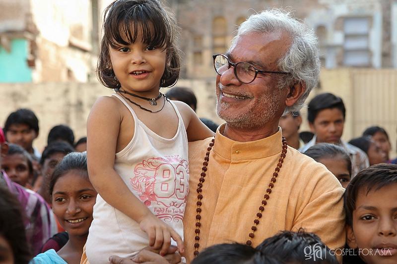 Dr KP Yohannan Metropolitan with a young girl at a Bridge of Hope center in India - KP Yohannan - Gospel for Asia