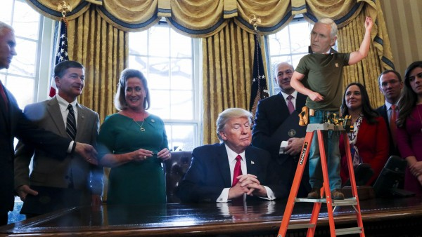 Seizing the initiative Vice President Pence measures Oval Office's drapes.