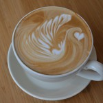 Latte with a swirl and heart in the foam