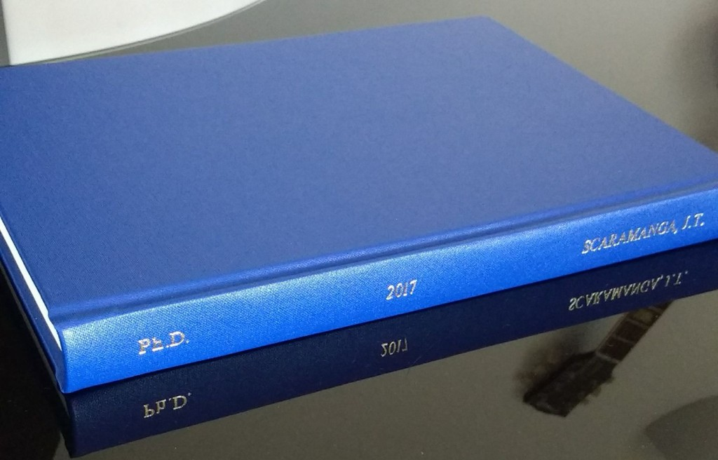Jonny's PhD thesis. It is hard-bound in medium blue, with gold lettering on the spine