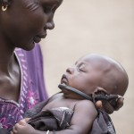 Yar Wadok, mother of 5, gave birth to her youngest, Akou Marial, 3 weeks, under a tree in the forests of Yolakot, South Sudan in Lake State where her family has sought temporary refuge. An estimated 716,100 have been displaced in South Sudan with an additional 166,900 fleeing to neighboring countries as a result of conflict that erupted in mid-December 2013. The Nile has become a lifeline for the people who have sought shelter along its shores. Catholic Relief Services and Caritas Internationalis have been responding with latrines, hand washing stations, and emergency shelter kits and non food items such as kitchen materials and hygiene materials.