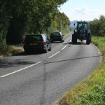 Tractor with Cars Passing