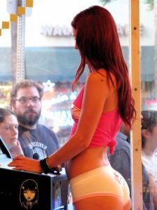 By Jason Afinsen https://en.wikipedia.org/wiki/Staring#/media/File:Scantily-clad_woman_standing_in_the_arcade_storefront_window.jpg