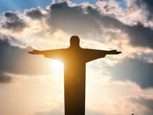 Faith-Christian-Jesus-Sky-Statue-Sun-Clouds_credit-Shutterstock
