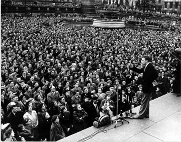 Talk about preaching that connects with people's lives! Billy Graham has been used by God to communicate with millions upon millions. In the picture above, he's speaking in Trafalgar Square in London in 1954. (Picture from the Billy Graham Center of Wheaton College.)