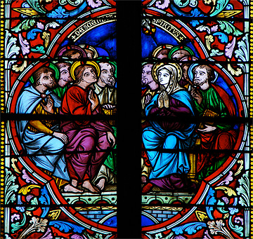 A stained glass window from the Meaux Cathedral in Meaux, France. Public domain.
