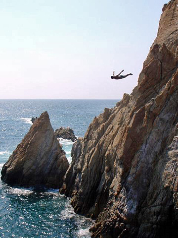 A cliff diver in Acapulco, Mexico. Now that's what I call a leap of faith!