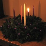 An Advent wreath with the first candle lit, signifiying our yearning for our shepherd.