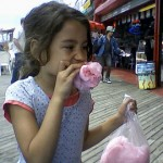 A girl enjoys way too much cotton candy for her own good at Coney Island, New York. http://www.flickr.com/photos/edenpictures/4697408476/