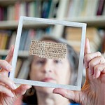 Professor Karen King displays the fragment of the so-called Gospel of Jesus's Wife. Photo from http://news.harvard.edu/gazette/wp-content/uploads/2012/09/090512_AncientPapyrus_1714_605.jpg