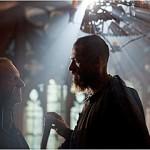 The Bishop, played by Colm Wilkinson, and Jean Valjean, played by Hugh Jackman