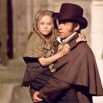 Jean Valjean (Hugh Jackman) carries young Cosette (Isabel Allen)