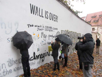 The Lennon Wall, a couple of days after it was painted white.