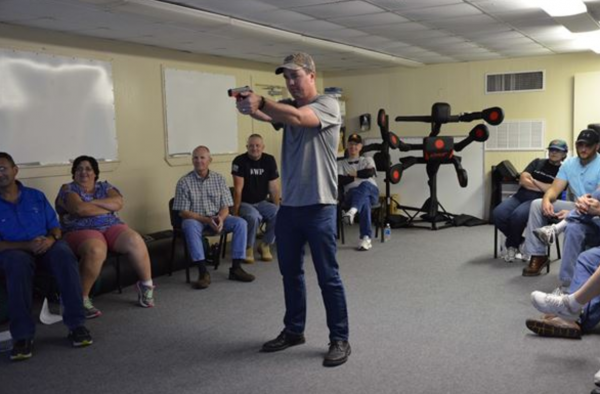 Col. Steven M. Gorski, commander of the Air Force Technical Applications Center, takes aim with a virtual handgun using a MILO simulator at the Brevard County Sheriff's Office firing range. Gorski and 24 members of his organization participated in BCSO's Self Defense Through Tactical Shooting and Decision Making course March 25, 2017. (U.S. Air Force photo by Susan A. Romano)