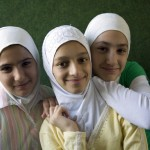 Students Hiba, Alaa', and Riham, from The Light in Her Eyes.