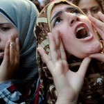 Women protesting in Egypt. Image via The Guardian.