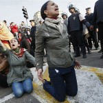 Women protest in Tahrir Square on January 25, 2011. Photo via Al Jazeera.
