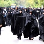 Iranian women dressed all in black. Via Global Post.
