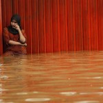 Extreme weather has caused flooding in several parts of the world. This week the Indonesian capital Jakarta was hit by torrential rain. This woman stands in front of her store in downtown Jakarta. Image by Al-Jazeera.
