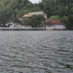 "The ""Golden Canopy"" of the Temple of the Tooth visible from the Kandy Lake."