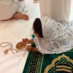My daughter Eryn stealing nuts during prayer.