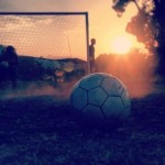 Soccer at sunset. Still image from the film Veils and Cleats. [Source].