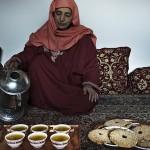A Kashmiri woman prepares kehwa, saffron tea. Kashmir is known for high-quality saffron, the world's most expensive spice. Image by Abid Bhat/BBC.