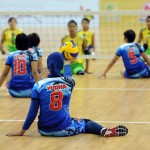 The Indonesian sitting volleyball team serves during the finals of Asean Para-Games in Burma/Myanmar, where nearly 2,000 athletes from 10 nations competed in 12 sports. Image by Philip Heijmans/Al Jazeera