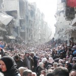 This shocking picture of thousands of people lining up for aid in Palestinian refugee camp Yarmouk in Damascus, Syria has been taken on January 31, but was just released this week. Image by UNRWA