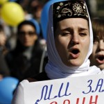 A Crimean Tatar woman during an anti-war rally in Bakhchisaray, Crimea. Tatars make up around 13% of the population in the Crimea and are, considering their history, wary of the Russian regime. Image by Vasily Fedosenko/Reuters