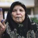 Another week, more elections. A Libyan woman holds up her ink-stained finger after voting in the municipal elections in the city of Benghazi. Image by Esam Omran Al-Fetori/Reuters