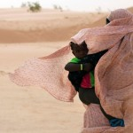 A Mauritanian woman shields her child from the wind. Mauritania had presidential elections on June 21st. Image by Joe Penney/Reuters