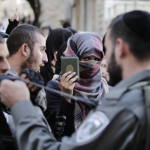 A Palestinian woman protests being blocked from entering the Al-Aqsa mosque in Jerusalem. During the weeklong Jewish celebration of Sukkot, Jews have been given access to the compound. Image by Ahmad Gharabli/AFP