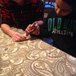 "Lil D making an ""acorn"" for Thanksgiving with his therapist."