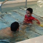 Lil D and his therapist in the pool.