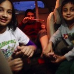 The siblings massage Lil D's feet on the ride to his grandparents' house