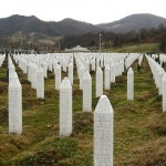 """Srebrenica massacre memorial gravestones 2009 1"" by Michael Büker - Own work. Licensed under CC BY-SA 3.0 via Wikimedia Commons"