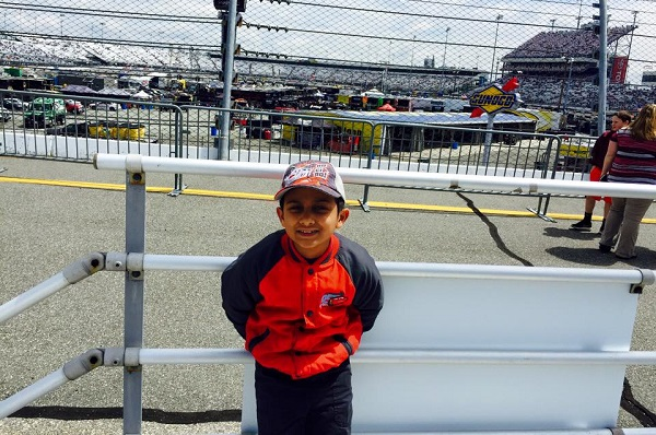 H picked out this photo of himself to share - at a Nascar event he attended with his Baba